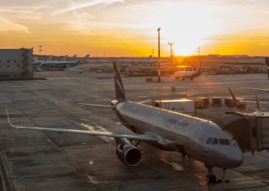 MOSCOW, RUSSIA, OCTOBER 07, 2018: The plane of the Russian airline Aeroflot fully prepared for the boarding of passengers on the background of the rising sun
