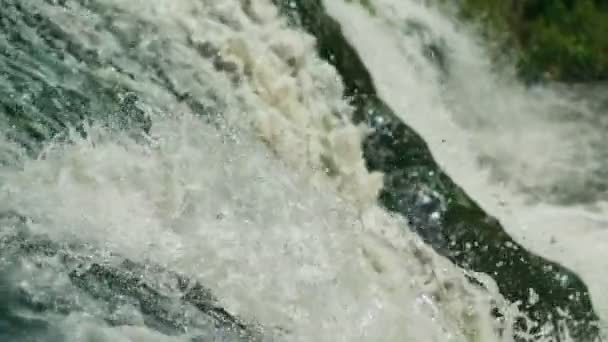 Close up Water dropping on stones, waterfall. Slow motion