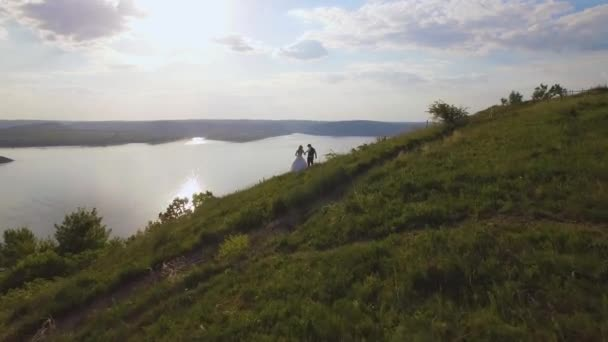 4K aerial drone footage of couple on the cliff. Amazing travel concept