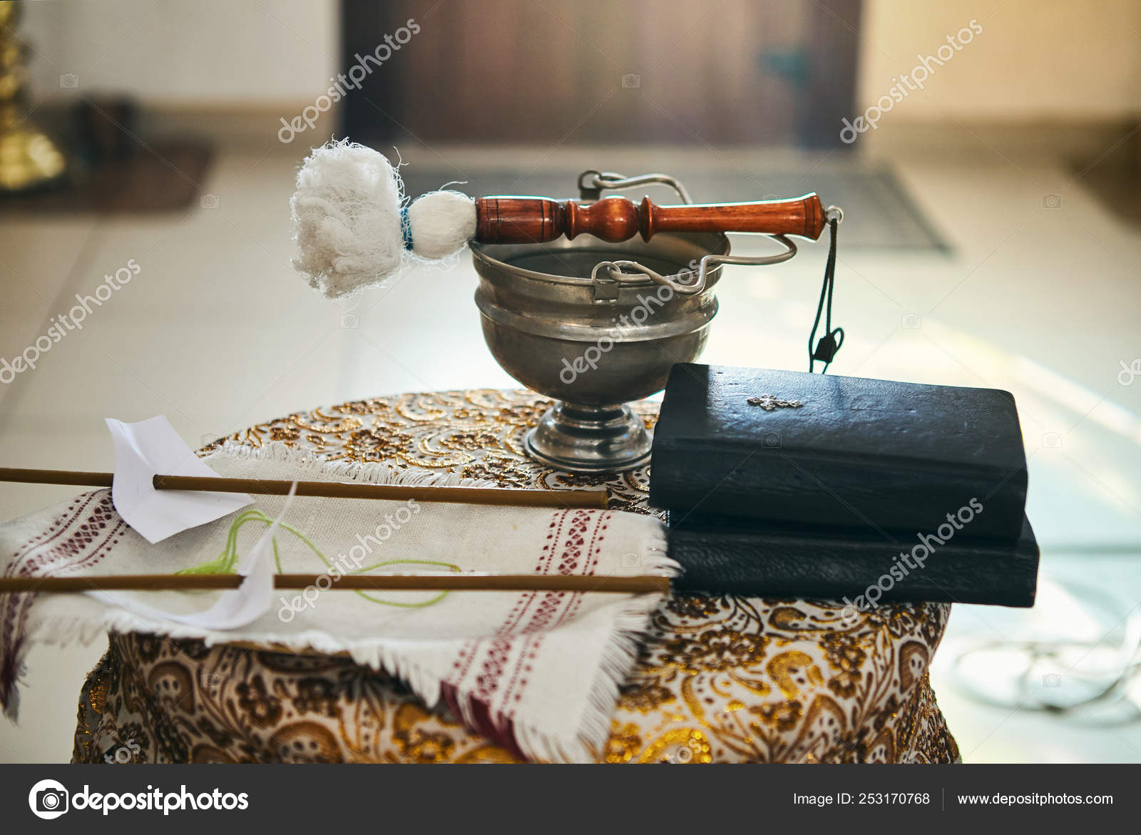 Orthodox Priest Holds A Bible On A Table With Various Objects