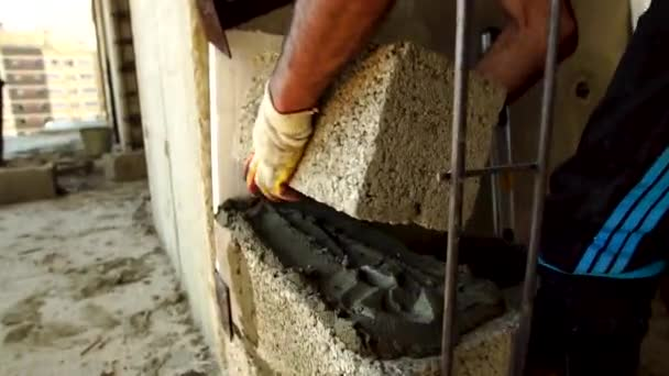 The Builder Builds A Concrete Wall With A Cement Block.