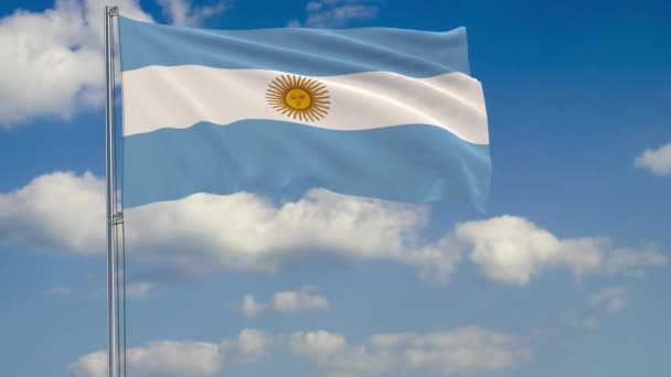 Flag of Argentina against background of clouds floating on the blue sky.