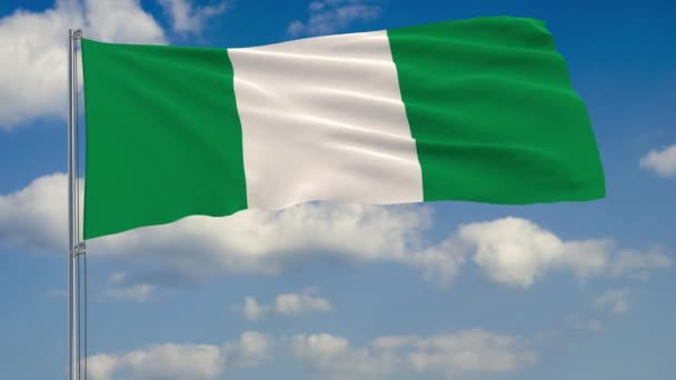 Flag of Nigeria against background of clouds sky