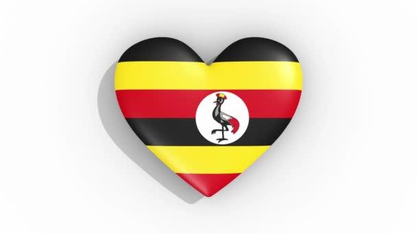 Heart in colors of flag of Uganda pulses, loop