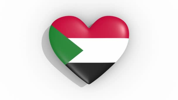 Heart in colors of flag of Sudan pulses, loop
