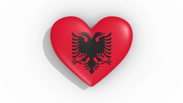 Heart in colors of flag of Albania pulses, loop.