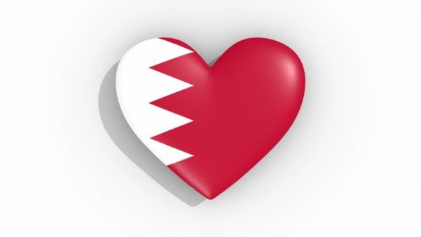Heart in colors of flag of Bahrain pulses, loop