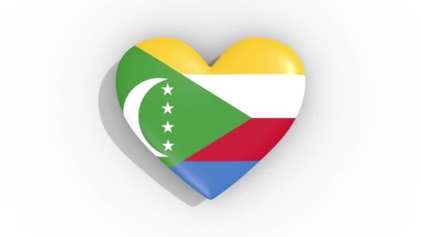 Heart in colors of flag of Comoros pulses, loop
