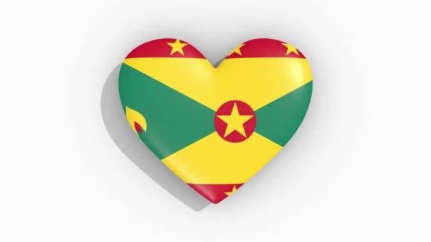 Heart in colors flag of Grenada pulses, loop