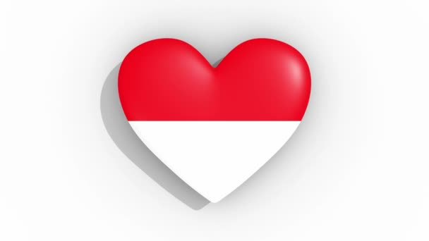 Heart in colors flag of Indonesia pulses, loop