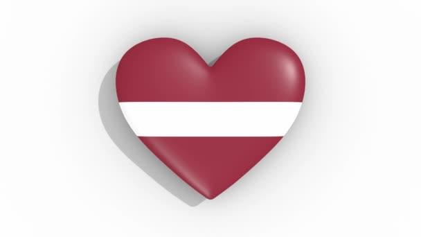 Heart in colors flag of Latvia pulses, loop