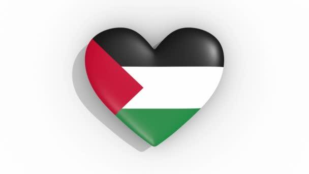 Heart in colors flag of Palestine pulses, loop