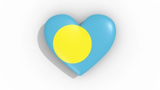 Heart in colors flag of Palau pulses, loop