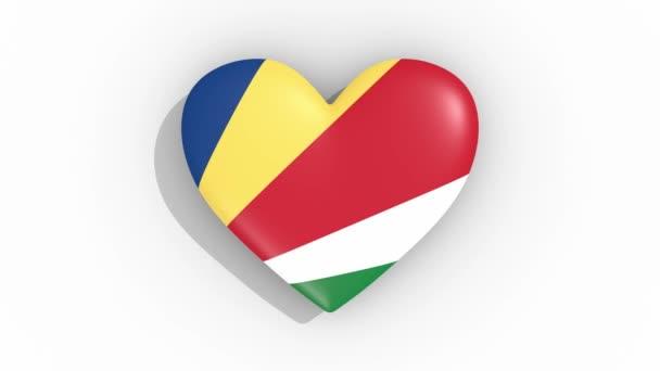 Heart in colors flag of Seychelles pulses, loop
