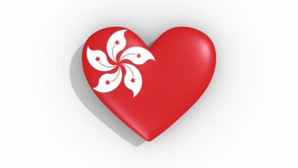 Heart in colors flag of Hong Kong pulses, loop