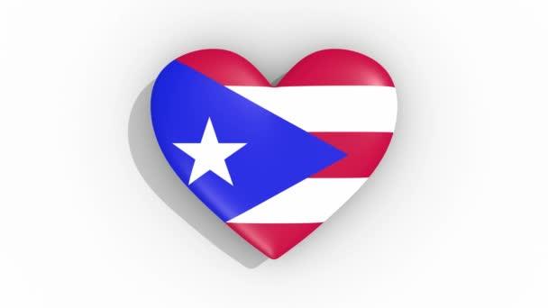 Heart in colors flag of Puerto Rico pulses, loop
