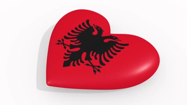 Heart in colors and symbols of Albania on white background, loop