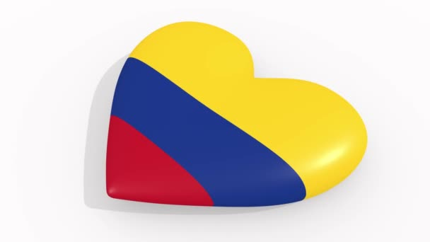 Heart in colors and symbols of Colombia on white background, loop