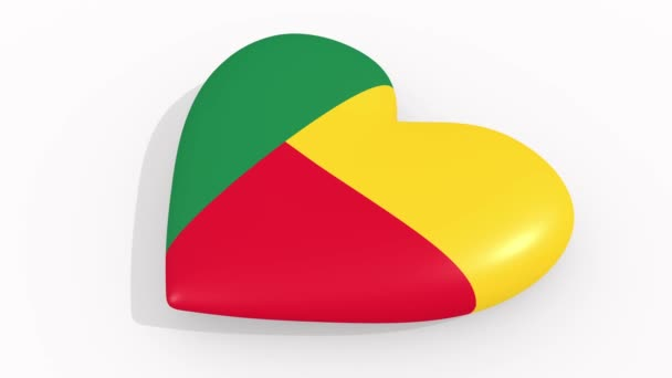 Heart in colors and symbols of Benin on white background, loop