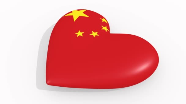 Heart in colors and symbols of China on white background, loop