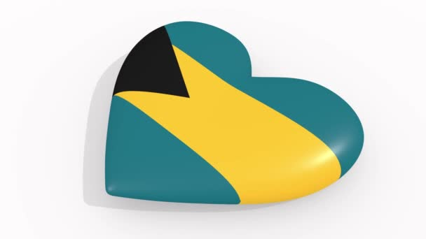 Heart in colors and symbols of Bahamas on white background, loop
