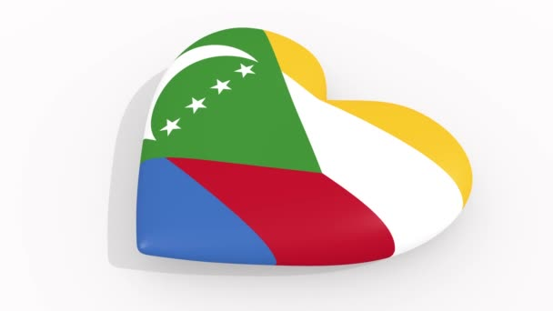 Heart in colors and symbols of Comoros on white background, loop