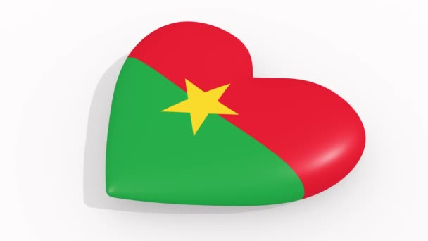 Heart in colors and symbols of Burkina Faso on white background, loop