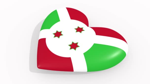 Heart in colors and symbols of Burundi on white background, loop
