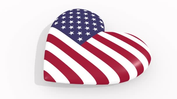 Heart in colors and symbols of United States of America on white background, loop