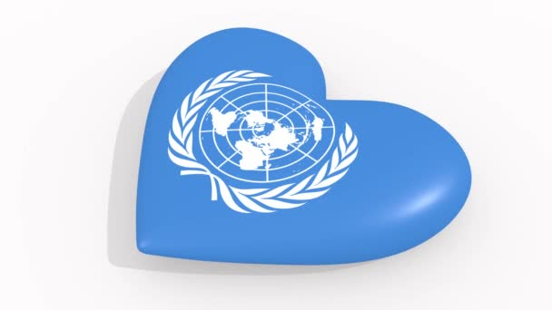Heart in colors and symbols of United Nations on white background, loop
