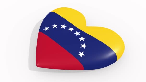 Heart in colors and symbols of Venezuela on white background, loop