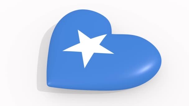 Heart in colors and symbols of Somalia on white background, loop