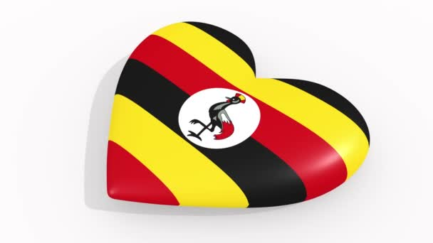 Heart in colors and symbols of Uganda on white background, loop