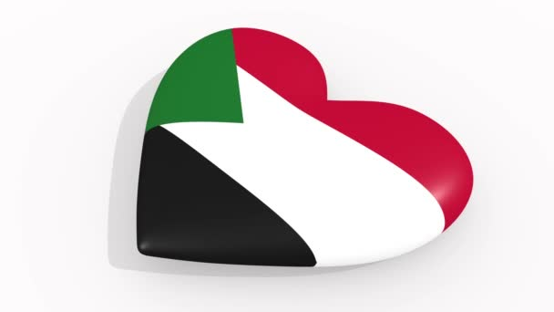 Heart in colors and symbols of Sudan on white background, loop