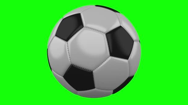 Fotbalový míč se otáčí na zeleném pozadí