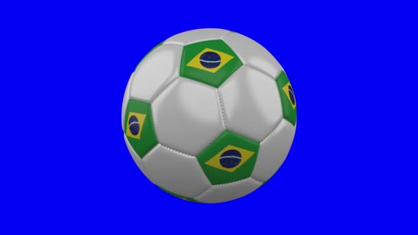 Soccer ball with Brazil flag on blue chroma key background, loop