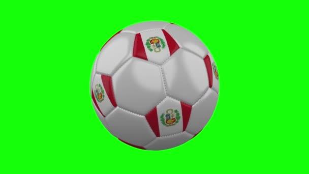 Fotbalový míč s peruánskou vlajkou na pozadí zeleného Chroma Key, smyčka