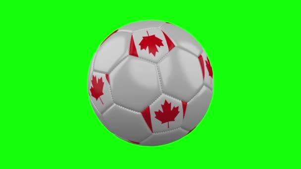 Soccer ball with Canada flag on green chroma key, loop