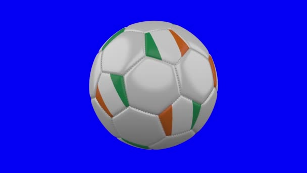 Soccer ball with Cote dIvoire - Ivory Coast flag on blue chroma key, loop