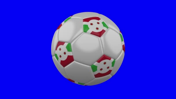 Soccer ball with Burundi flag on blue chroma key background, loop