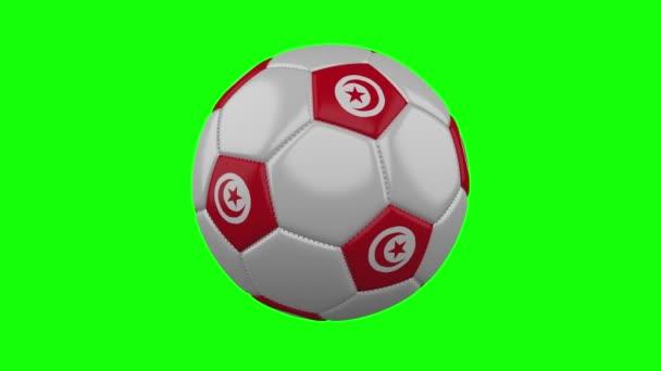 Fotbalová koule s Tuniskou vlajkou na pozadí zeleného Chroma Key, smyčka