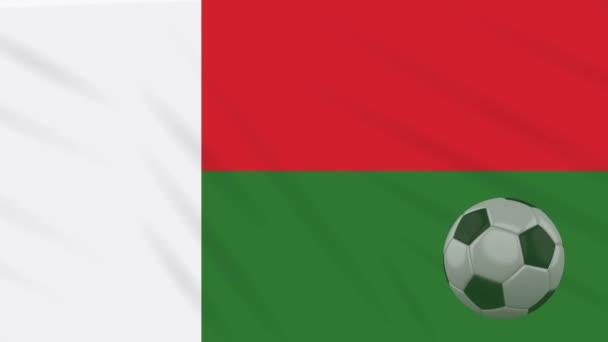 Rotaci vlajky Madagaskaru a fotbalový míč, smyčka