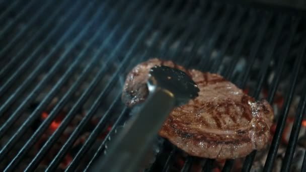 Close up of beef steak, which is being taken away from bbq in the restaurant, slow motion.