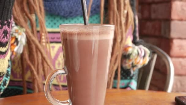 cocoa or hot chocolate cup in womans hand