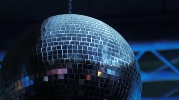 Old disco ball spin in night club close up