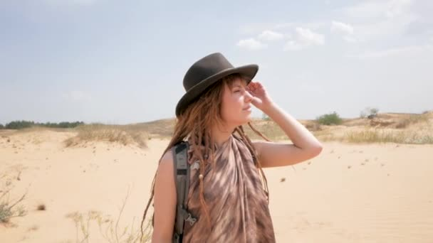 Young woman hiker travel alone with backpack in desert
