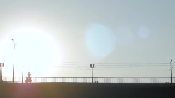 silhouette bicycle of bicycle rider on the bridge against sunset, minimalistic urban landscape