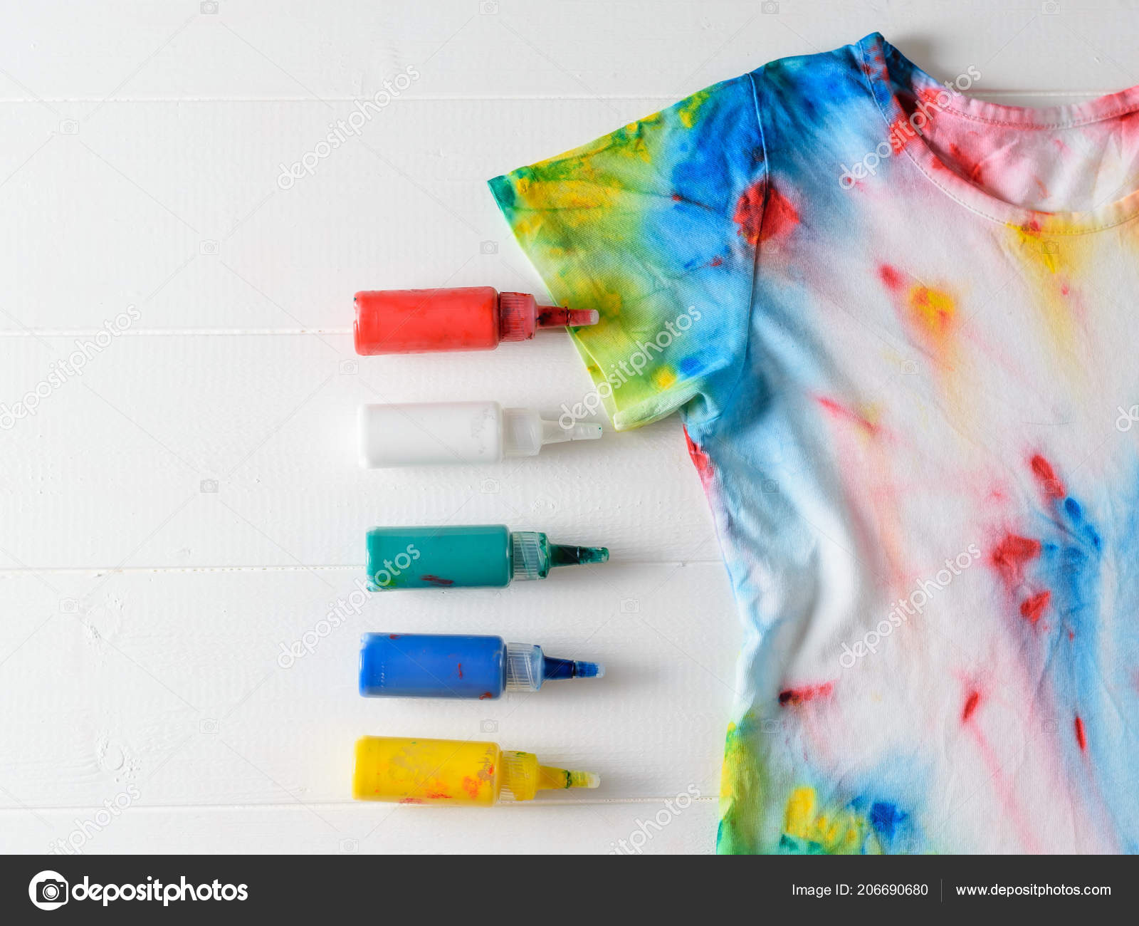c5431749 Tubes Paint Clothes Shirt Tie Dye Style White Wooden Table — Stock Photo