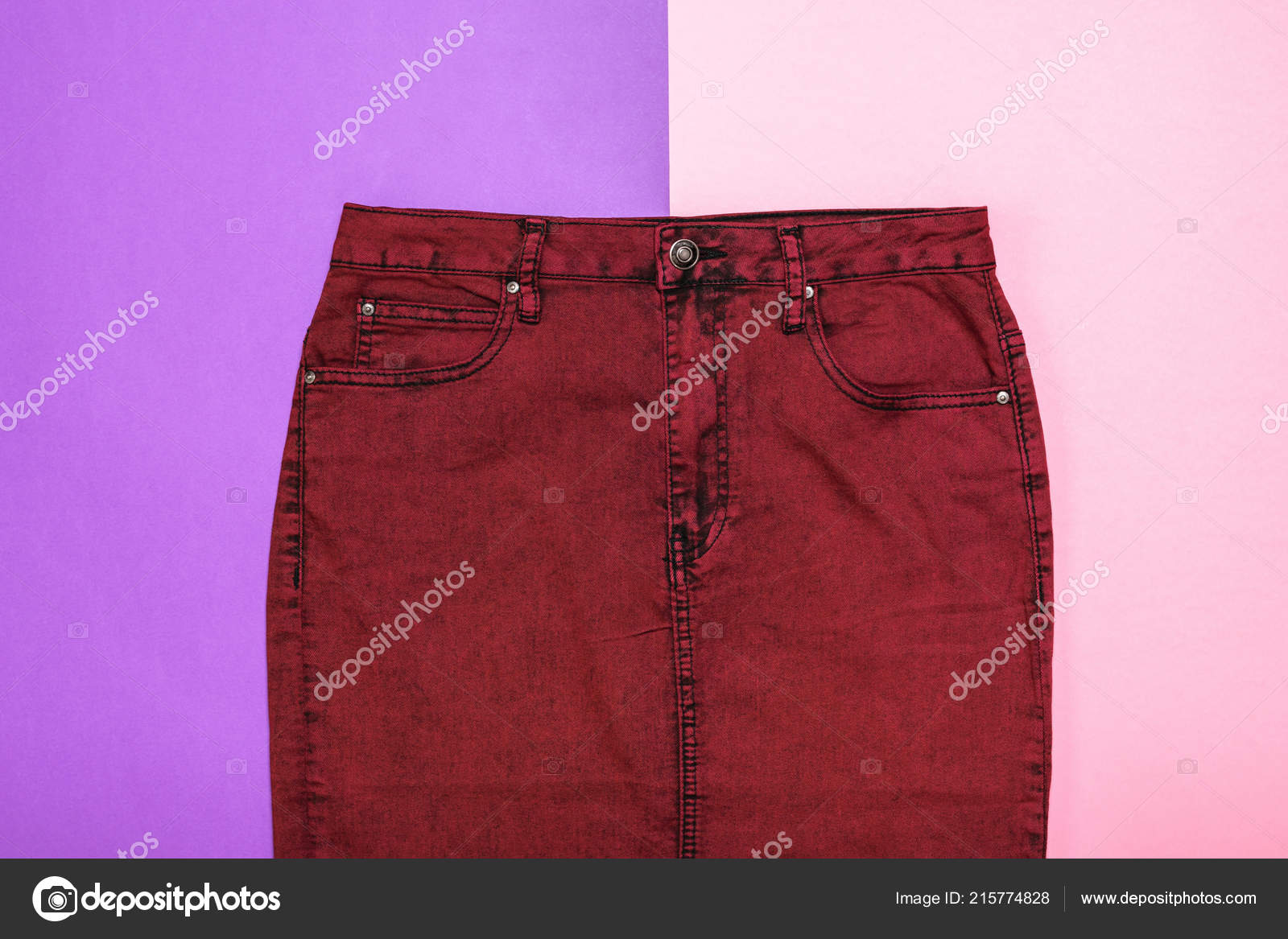 7eb48dbd5 Burgundy denim skirt on two colors background. Fashionable denim women's  clothing. Denim women's clothing on colored background.