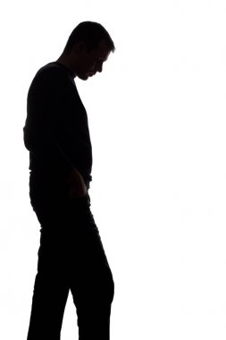 Portrait of a young man, side view - dark isolated silhouette